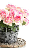Beautiful bouquet of pink roses in wicker vase, isolated on white — Stock Photo