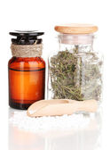 Tablets and bottles with herbs and mixture isolated on white — Stock Photo