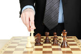 Businessman playing chess isolated on white — Stock Photo