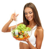 Beautiful young woman with salad, isolated on white — Stock Photo