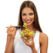 Hermosa joven con ensalada, aislado en blanco — Foto de Stock