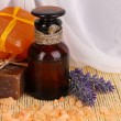 Bottle with aromatic oils with accessories for relaxation close-up on woode — Stock Photo