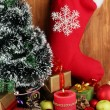 Composition from Christmas decorations on wooden table on wooden background - Stock Photo