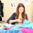 Beautiful young dressmaker in workroom — Stock Photo #13925051