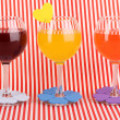 Royalty-Free Stock Photo: Colorful cocktails with bright decor for glasses on red background