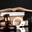Gavel, handcuffs and books on law isolated on black close-up — Stock Photo #13925183