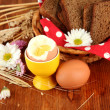 Boiled eggs on wooden background — Stock Photo