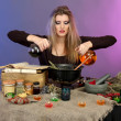 Halloween witch preparing poison soup in her cauldron on color background - Stock Photo