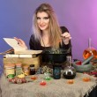 Halloween witch preparing poison soup in her cauldron on color background — Stock Photo