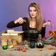 Halloween witch preparing poison soup in her cauldron on color background — Stock Photo #13927164