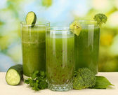Three kinds of green juice on bright background — Stok fotoğraf
