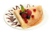 Delicious pancakes with berries,chocolate and honey on plate — Stock Photo