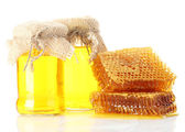 Sweet honeycombs and jars with honey, isolated on white — Stock Photo