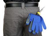 Yakın çekim eldiven ve aletleri arka cep — Stok fotoğraf