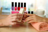 Manicure process in beauty salon, close up — Stock fotografie