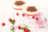 Fruit jelly with berries in glasses on wooden table — Stock Photo