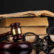 Gavel, handcuffs andbooks on law isolated on black close-up — Stock Photo