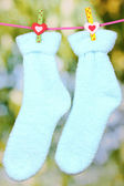 Pair of blue socks hanging to dry — Stock Photo