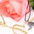 Tender pink rose with heart pendant — Stock Photo #14016281