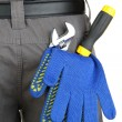 Gloves and instruments in back pocket close-up — Стоковая фотография