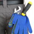 Gloves and instruments in back pocket close-up — Photo