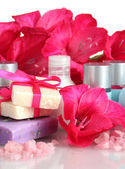 Cosmetic bottles, soap and flowers — Stock Photo