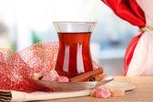 Glass of Turkish tea and rahat lokum, on wooden table — Stock Photo