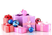 Colorful gifts with Christmas balls isolated on white — Stock Photo