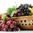 Assortment of ripe sweet grapes in basket, isolated on white - Foto de Stock