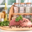 A large piece of pork marinated with herbs, spices and cooking oil on board - Foto de Stock