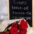 Wonderful bouquet of red roses with tablet on their selling - Stock Photo