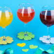 Colorful cocktails with bright decor for glasses on blue background — Stock Photo #14034757