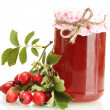Jar with hip roses jam and ripe berries, isolated on white - Stock Photo