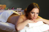 Beautiful young woman in spa salon — Stock Photo