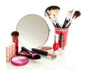 Cosmetics near mirror isolated on white — Stock Photo