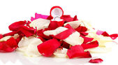Beautiful box with ring on red, white and pink rose petals isolated on whit — Stock Photo
