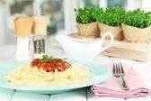 Italian spaghetti served in cafe — Stock Photo