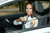 Beautiful young woman in car — Stok fotoğraf