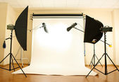 Empty photo studio with lighting equipment — ストック写真