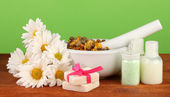 Ingredients for soap making on green background — Stock Photo