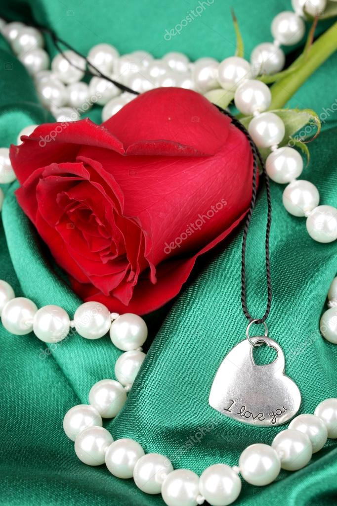 Beautiful red rose with heart pendant  Stock Photo #14039127