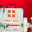 Royalty-Free Stock Photo: First aid box, on red background