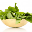 Fresh spinach in wooden bowl isolated on white — Stock Photo #14042604