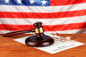 Divorce decree and wooden gavel on american flag background — Stock Photo
