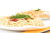 Composition of delicious cooked spaghetti with tomato sauce on white backgr — Stock Photo