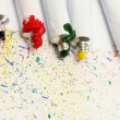 Stock Photo: Tubes with colorful watercolors on colorful splash background close-up
