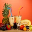 Milk shakes with fruit on red background close-up — Stock Photo #14079182