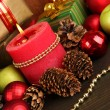 Composition from Christmas decorations close-up on wooden table on wooden b — Stock Photo