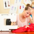 Beautiful young dressmaker in workroom — Stock Photo #14079506