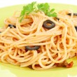 Italian spaghetti in plate close-up - Stock Photo